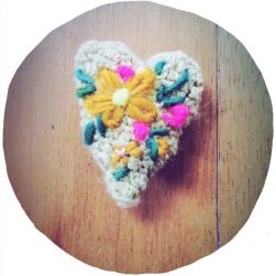 heart brooch with flower embroidery.
